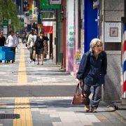 Elderly woman on sidewalk; Ginza, Tokyo