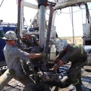 Public domain photo of roughnecks at an oil well, by NIOSH