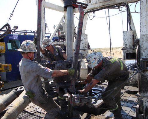 Public domain photo of roughnecks at an oil well, by NIOSH