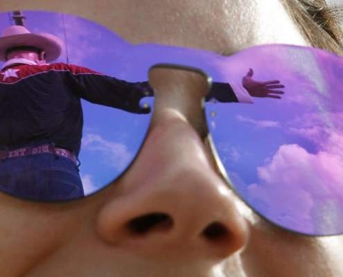 Big Tex is reflected in Simone Elices' sunglasses in Dallas on Sept. 23, 2016. (Paul Moseley/Fort Worth Star-Telegram/TNS via Getty Images)