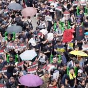 Hong Kong protest, modified with symbols that represent facial recognition technology