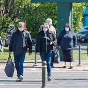People wearing face masks as they head to work