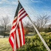 US Flag hanging on suburban porch