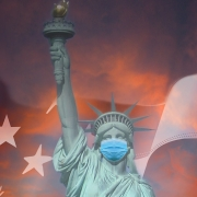Lady Liberty under dramatic skies, with a face mask