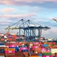 Cargo backlog, shipping containers stacked up at port